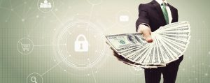 Man in suit holding CMS reimbursement money with cybersecurity icons